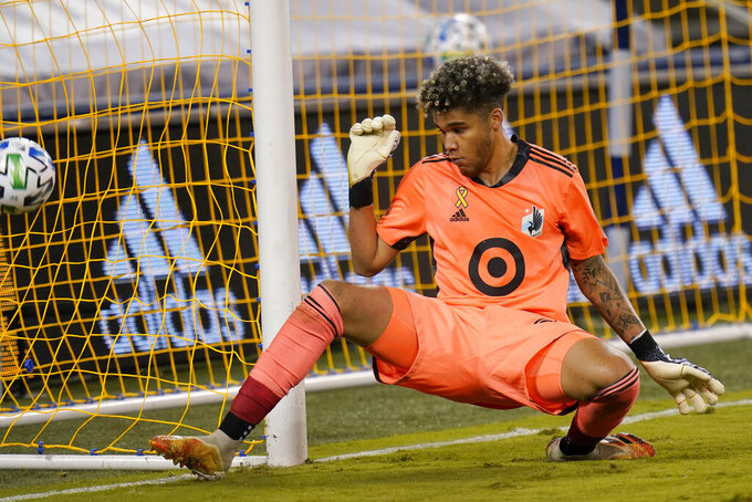 Minnesota United goalkeeper Dayne St. Clair defends the post during the first half of an MLS soccer match against Sporting Kansas City in Kansas City, Kan., Sunday, Sept. 13, 2020. (AP Photo/Orlin Wagner)