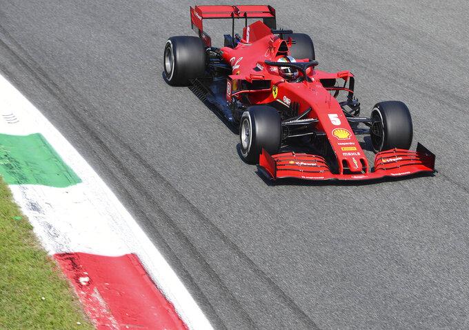 Ferrari driver Sebastian Vettel of Germany steers his car during the Formula One Grand Prix at the Monza racetrack in Monza, Italy, Sunday, Sept.6 , 2020. (Jennifer Lorenzini, Pool via AP)