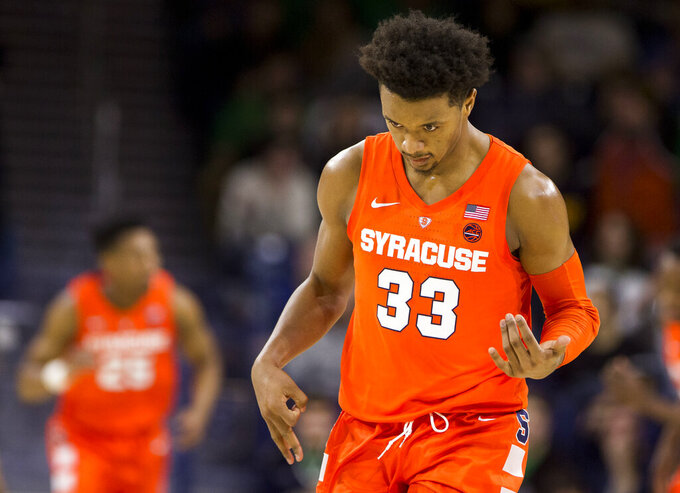 Syracuse's Elijah Hughes (33) mimics playing a guitar as he celebrates after scoring during the second half of an NCAA college basketball game against Notre Dame, Saturday, Jan. 5, 2019, in South Bend, Ind. Syracuse won 72-62. (AP Photo/Robert Franklin)