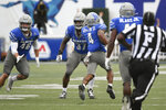 Memphis wide receiver Calvin Austin III (4) runs back a punt for a touchdown during the final minutes of an NCAA college football game against Mississippi State, Saturday, Sept. 18, 2021, in Memphis, Tenn. (AP Photo/John Amis)