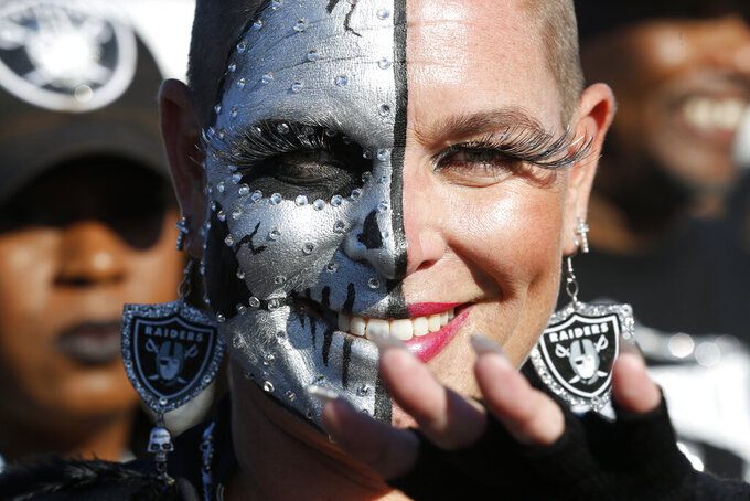 "An Oakland Raiders fan who calls herself ""Jersey Tucker,"" from Las Vegas, tailgates before the start of an NFL football game between the Oakland Raiders and the Denver Broncos Monday, Sept. 9, 2019, in Oakland, Calif. (AP Photo/D. Ross Cameron)"