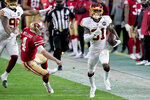 Washington Football Team strong safety Kamren Curl (31) runs back an interception for a touchdown as San Francisco 49ers quarterback Nick Mullens (4) tries to defend during the second half of an NFL football game, Sunday, Dec. 13, 2020, in Glendale, Ariz. (AP Photo/Ross D. Franklin)
