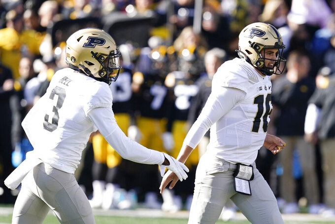 Purdue quarterback Aidan O'Connell (16) celebrates with teammate wide receiver David Bell (3) after scoring on a 6-yard touchdown run during the first half of an NCAA college football game against Iowa, Saturday, Oct. 16, 2021, in Iowa City, Iowa. (AP Photo/Charlie Neibergall)