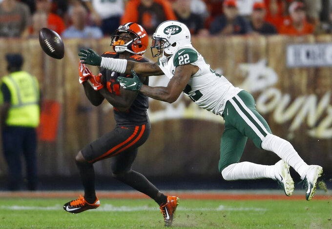 FILE - In this Sept. 20, 2018, file photo, New York Jets defensive back Trumaine Johnson (22) breaks up a pass intended for Cleveland Browns wide receiver Antonio Callaway (11) during the first half of an NFL football game in Cleveland. Johnson might be the most important Jets player not named Sam Darnold, Le'Veon Bell or Jamal Adams. (AP Photo/Ron Schwane, File)