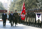 Turkish Defence Minister Hulusi Akar, left, and Russia's Defence Minister Sergei Shoigu inspect a military honour guard before their talks in Ankara, Turkey, Monday, Feb. 11, 2019. Shoigu said at the start of Monday's meeting with his Turkish counterpart Akar that the two countries' experts have done