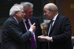 French Foreign Minister Jean-Yves Le Drian, right, speaks with Spanish Foreign Minister Josep Borrell, left, and Luxembourg's Foreign Minister Jean Asselborn during an EU Foreign Ministers meeting at the European Council headquarters in Brussels, Monday, Feb. 18, 2019. US President Donald Trump's demand that European countries take back their nationals fighting in Syria is receiving mixed reactions, as nations pondered how to bring home-grown Islamic State extremists to trial. (AP Photo/Francisco Seco)
