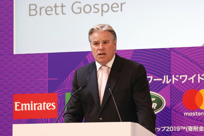 """FILE - In this Wednesday, June 12, 2019, file photo, Brett Gosper, CEO of World Rugby, delivers a speech in Tokyo. As the NFL returns to London, the league is also finalizing its short list of German cities to host a game as early as next season. Brett Gosper, NFL Head of UK and Europe, said the opening of an office in Germany is """"reasonably imminent,"""" as is the hiring of a general manager there as the league looks to expand across Europe, with France also in its sights. (AP Photo/Koji Sasahara, File)"""