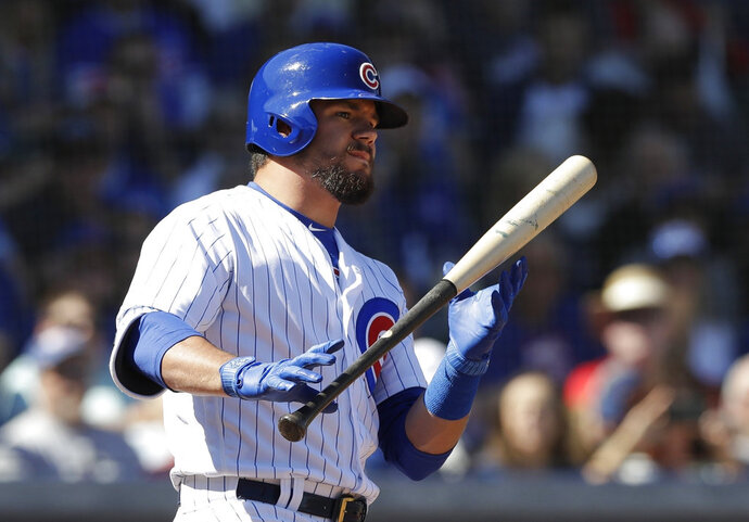 FILE - In this Feb. 27, 2018, file photo, Chicago Cubs' Kyle Schwarber bats during the first inning of the team's spring training baseball game against the Chicago White Sox in Mesa, Ariz. Schwarber has a $604,500 salary in the major leagues as part of the one-year contract the Chicago Cubs announced last weekend. The outfielder's salary would drop to $271,150 while in the minor leagues as part of the split contract. It represents a slight raise from last year, when his contract was for $565,500 in the majors and $261,000 in the minors. Schwarber is on track to be eligible for salary arbitration next winter. (AP Photo/Carlos Osorio, File)