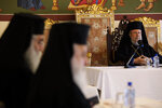 The head of Cyprus Orthodox Church Archbishop Chrysostomos II, right, presides over a meeting of other bishops composing the Holy Synod, the Church's highest decision-making body at the Church's headquarters in the capital Nicosia, Cyprus, on Monday, Nov. 23, 2020. The Holy Synod convened to discuss issues relating to the Cyprus Church's position on the independence of the Ukrainian Orthodox Church. (AP Photo/Petros Karadjias)