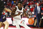 Georgia's Anthony Edwards (5) moves the ball against a Western Carolina defender during an NCAA college basketball game Tuesday, Nov. 5, 2019, in Athens, Ga. (Joshua L. Jones/Athens Banner-Herald via AP)