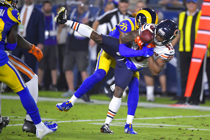 Los Angeles Rams cornerback Jalen Ramsey breaks up a pass intended for Chicago Bears wide receiver Taylor Gabriel, right, during the first half of an NFL football game Sunday, Nov. 17, 2019, in Los Angeles. (AP Photo/Mark J. Terrill)