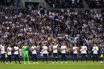 Tottenham players stand on the pitch applauding in a tribute to former player Jimmy Greaves before the English Premier League soccer match between Tottenham Hotspur and Chelsea at the Tottenham Hotspur Stadium in London, England, Sunday, Sep. 19, 2021. Greaves, one of England's greatest goal-scorers who was prolific for Tottenham, Chelsea and AC Milan has died. He was 81. Greaves was the all-time record scorer for Tottenham, which announced his death on Sunday. (AP Photo/Matt Dunham)