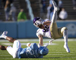North Carolina's Giovanni Biggers (27) stops Western Carolina's Clayton Bardall (86) after a 13-yard pass reception from quarterback Will Jones in the second half of an NCAA college football game on Saturday, Dec. 5, 2020, at Kenan Stadium in Chapel Hill, N.C. (Robert Willett/The News & Observer via AP)
