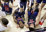 Liberty guard Lovell Cabbil Jr. (3) and guard Georgie Pacheco-Ortiz (11) celebrate after Liberty beat Lipscomb in the Atlantic Sun NCAA college basketball tournament championship game Sunday, March 10, 2019, in Nashville, Tenn. Liberty won 74-68. (AP Photo/Mark Humphrey)
