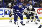 Tampa Bay Lightning center Anthony Cirelli (71) breaks out ahead of Buffalo Sabres left wing C.J. Smith (49) and center Vladimir Sobotka (17), of the Czech Republic, during the second period of an NHL hockey game Thursday, Feb. 21, 2019, in Tampa, Fla. (AP Photo/Chris O'Meara)