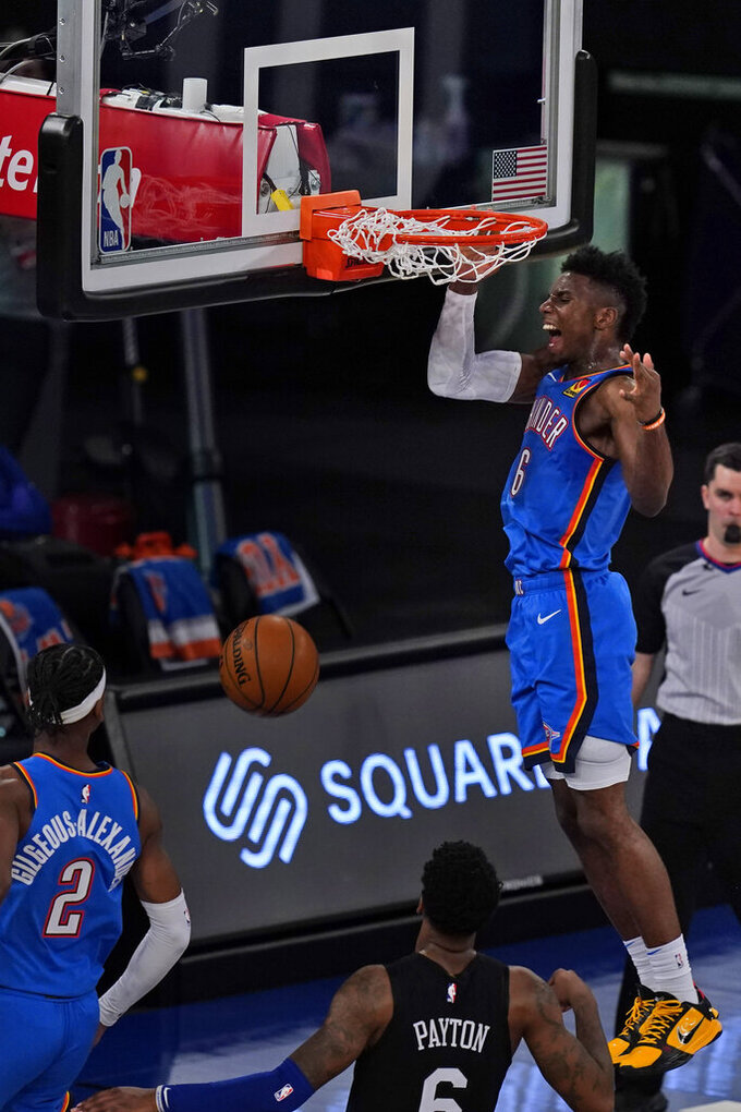Oklahoma City Thunder's Hamidou Diallo completes an alley-oop during the second half of an NBA basketball game against the New York Knicks, Friday, Jan. 8, 2021, in New York. (AP Photo/Seth Wenig, Pool)