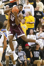 Texas A&M's Josh Nebo, right, pulls down a rebound in front of Missouri's Torrence Watson, left, during the second half of an NCAA college basketball game Tuesday, Jan. 21, 2020, in Columbia, Mo. Texas A&M won the game 66-64. (AP Photo/L.G. Patterson)