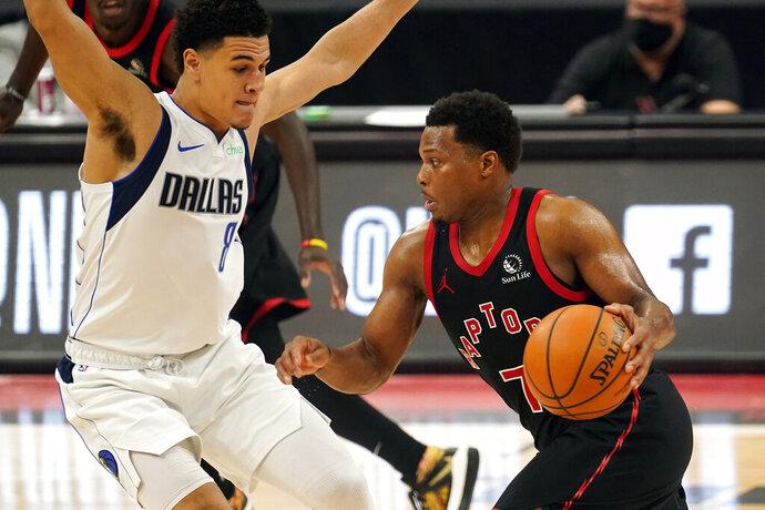 Toronto Raptors guard Kyle Lowry (7) drives against Dallas Mavericks guard Josh Green (8) during the second half of an NBA basketball game Monday, Jan. 18, 2021, in Tampa, Fla. (AP Photo/Chris O'Meara)