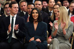 White House senior adviser Jared Kushner and Ivanka Trump, right, sit with Kim Kardashian West, who is among the celebrities who have advocated for criminal justice reform, as they listen to President Donald Trump speak about second chance hiring in the East Room of the White House, Thursday June 13, 2019, in Washington. (AP Photo/Evan Vucci)