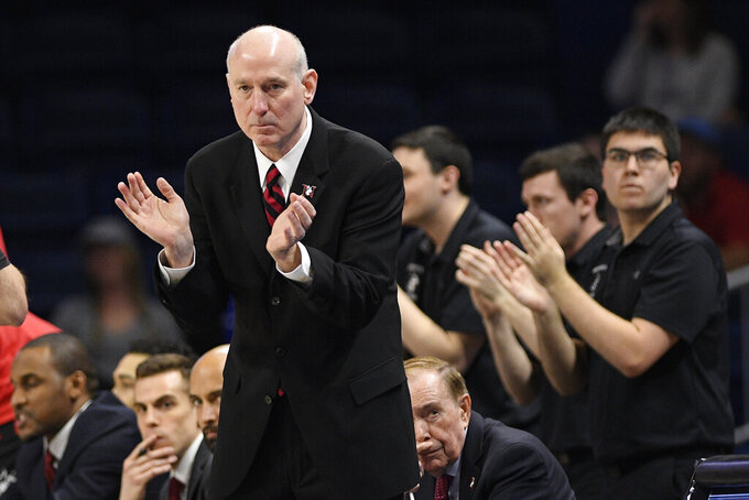 Northeastern coach Bill Coen reacts during the first half of the team's NCAA college basketball game against Hofstra for the championship of the Colonial Athletic Association men's tournament Tuesday, March 10, 2020, in Washington. (AP Photo/Nick Wass)