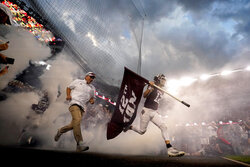 Texas A&M head coach Jimbo Fisher, left, and safety Connor Choate (12) lead the Aggies onto Kyle Field before an NCAA college football game against South Carolina, Saturday, Oct. 23, 2021, in College Station, Texas. (AP Photo/Sam Craft)
