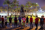 Pro-democracy football fans gather to form a human chain near a bronze statue of Britain's Queen Victoria at Hong Kong's Victoria Park, Wednesday, Sept. 18, 2019. An annual fireworks display in Hong Kong marking China's National Day on Oct. 1 was called off Wednesday as pro-democracy protests show no sign of ending. (AP Photo/Kin Cheung)