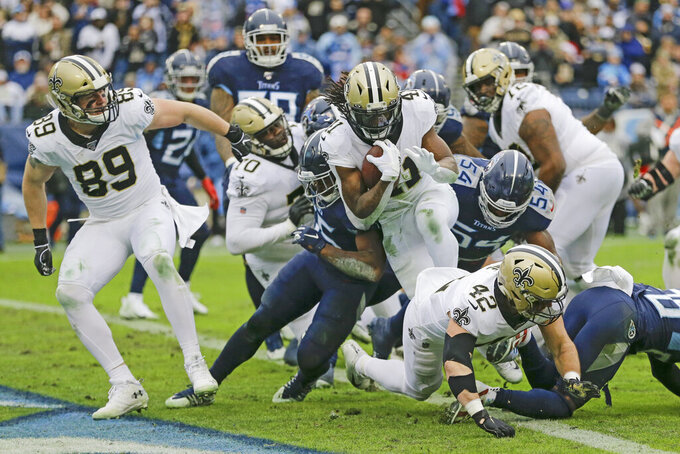 New Orleans Saints running back Alvin Kamara (41) follows the blocking of Josh Hill (89) and Zach Line (42) as Kamara scores a touchdown against the Tennessee Titans in the second half of an NFL football game Sunday, Dec. 22, 2019, in Nashville, Tenn. (AP Photo/James Kenney)