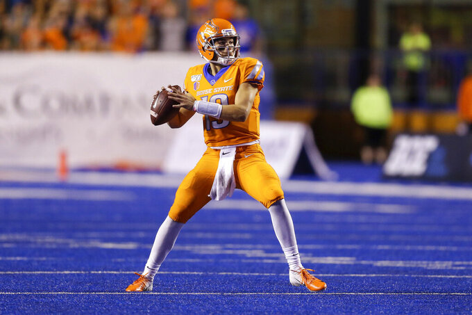 Boise State quarterback Hank Bachmeier looks for a receiver during the first half against Portland State in an NCAA college football game Saturday, Sept. 14, 2019, in Boise, Idaho. (AP Photo/Steve Conner)