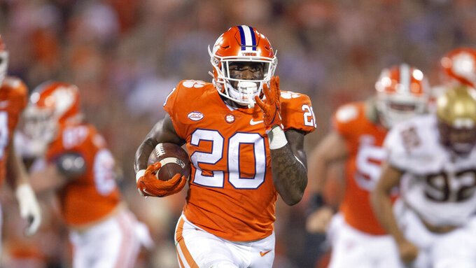 Clemson running back Kobe Pace (20) breaks away for a touchdown during the half of an NCAA college football game, against Boston College Saturday, Oct. 02, 2021, in Clemson, S.C. (AP Photo/Hakim Wright Sr.)