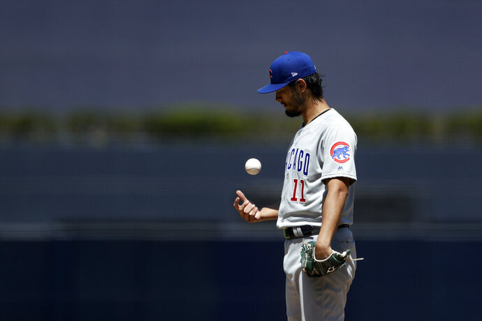 Chicago Cubs starting pitcher Yu Darvish tosses the ball as he works against a San Diego Padres batter during the first inning of a baseball game Thursday, Sept. 12, 2019, in San Diego. (AP Photo/Gregory Bull)
