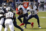 Tennessee Titans quarterback Ryan Tannehill (17) hands off to running back Derrick Henry in the first half of an NFL football game against the Jacksonville Jaguars Sunday, Sept. 20, 2020, in Nashville, Tenn. (AP Photo/Mark Zaleski)