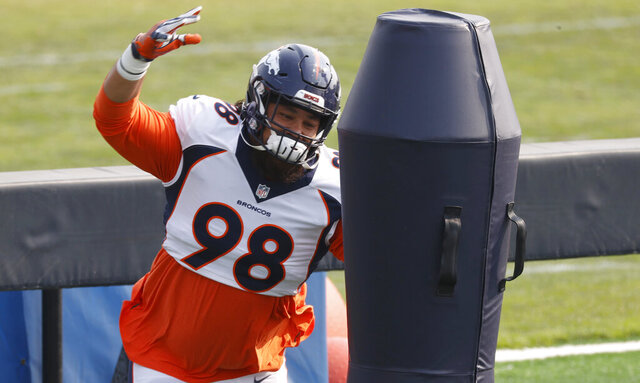 Denver Broncos nose tackle Mike Purcell takes part in drills during ] NFL football training camp Friday, Aug. 21, 2020, in Englewood, Colo. (AP Photo/David Zalubowski)