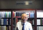 In this Aug. 28, 2019 photo, University of Vermont Professor Wolfgang Mieder stands among his vast collection of books on proverbs, now housed in a new library collection at the school in Burlington, Vt. The preeminent proverb scholar had been concerned about what would happen to his collection if something happened to him. (AP Photo/Lisa Rathke)