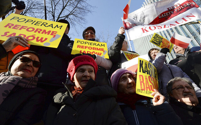 Supporters of Poland's right-wing government rally to show their support for legislation which gives the government greater control of judges, in Warsaw, Poland, Saturday, Feb. 8, 2020. Those gathered urged the government not to given in to the European Union, which has criticized recently passed legislation which gives the government the power to fire judges whose rulings authorities do not like. They called the judicial changes a matter of national sovereignty. On yellow banners we read