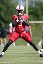 In this photo taken Tuesday, Aug. 6, 2019 North Carolina State wide receiver Emeka Emezie (3) warms up during an NCAA college football practice in Raleigh, N.C. (AP Photo/Gerry Broome)