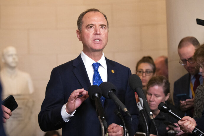 House Intelligence Committee Chairman Adam Schiff, D-Calif., speaks to reporters during a break on the public impeachment hearing of President Donald Trump's efforts to tie U.S. aid for Ukraine to investigations of his political opponents on Capitol Hill in Washington, Wednesday, Nov. 20, 2019. (AP Photo/Manuel Balce Ceneta)