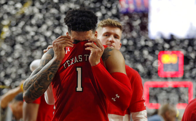 Texas Tech guard Brandone Francis reacts at the end of the championship game against Virginia in the Final Four NCAA college basketball tournament, Monday, April 8, 2019, in Minneapolis. Virginia won 85-77 in overtime. (AP Photo/Charlie Neibergall)