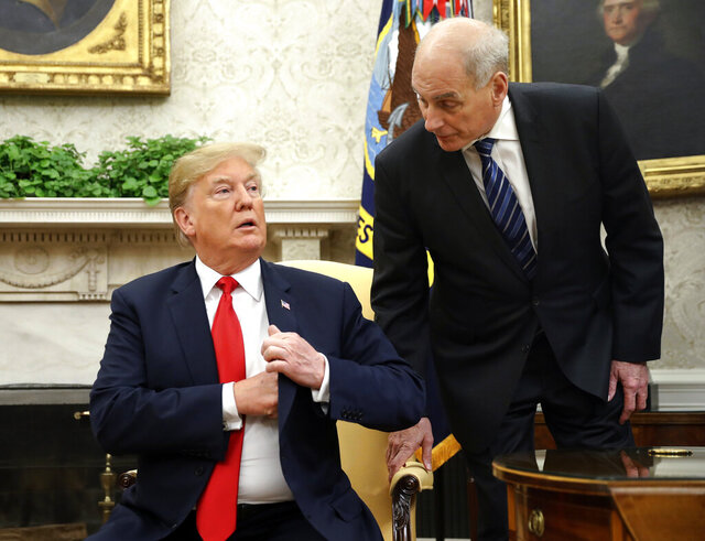 FILE - In this June 27, 2018 file photo, White House Chief of Staff John Kelly, right, leans in to talk with President Donald Trump during Trump's meeting with Portuguese President Marcelo Rebelo de Sousa, in the Oval Office of the White House in Washington.  Kelly is defending former White House national security aide, Army Lt. Col. Alexander Vindman, who raised concerns about President Donald Trump's phone call with Ukraine's president that spurred his impeachment. Kelly made the comments at a public forum Wednesday evening in Morristown, New Jersey.   (AP Photo/Pablo Martinez Monsivais)