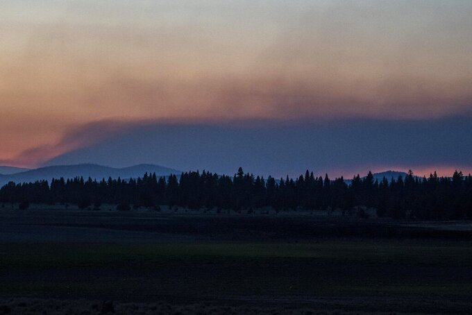 Smoke rises from the Bootleg Fire on Wednesday, July 21, 2021 near Bly, Ore. (AP Photo/Nathan Howard)