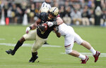 Purdue wide receiver Rondale Moore (4) is tacked by Boston College linebacker Connor Strachan (13) during the first half of an NCAA college football game in West Lafayette, Ind., Saturday, Sept. 22, 2018. (AP Photo/Michael Conroy)