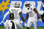 Las Vegas Raiders wide receiver Nelson Agholor (15) celebrates with teammate wide receiver Henry Ruggs III (11) after scoring a touchdown during the second half of an NFL football game against the Los Angeles Chargers, Sunday, Nov. 8, 2020, in Inglewood, Calif. (AP Photo/Alex Gallardo)