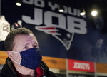 Football fan Brian Pope speaks to a reporter in the pro shop at Gillette Stadium, Monday, Jan. 25, 2021, in Foxborough, Mass. Tom Brady is going to the Super Bowl for the 10th time, and New England Patriots football fans are cheering for him -- just like before. (AP Photo/Elise Amendola)
