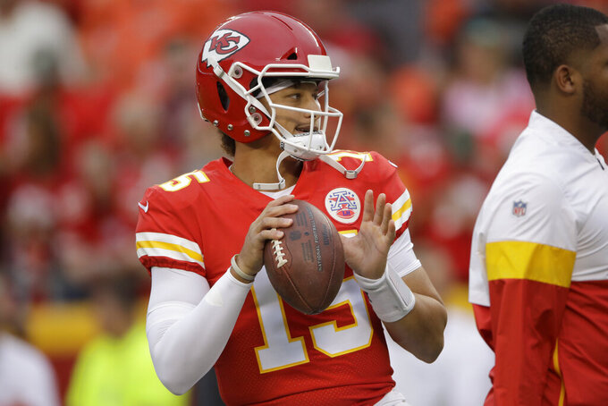 Kansas City Chiefs quarterback Patrick Mahomes (15) warms up before an NFL preseason football game against the San Francisco 49ers in Kansas City, Mo., Saturday, Aug. 24, 2019. (AP Photo/Charlie Riedel)