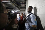 New Orleans Pelicans rookie forward Zion Williamson (1) is interviewed in a hallway after defeating the Atlanta Hawks in a preseason NBA basketball game Monday, Oct. 7, 2019, in Atlanta. (AP Photo/John Bazemore)