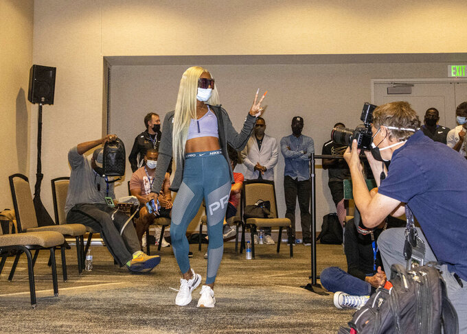 Sha'carri Richardson gestures Friday, Aug. 20, 2021, during a news conference a day before competing in the 100 meters at the Pre Classic track and field meet in Eugene, Ore. (AP Photo/Thomas Boyd)