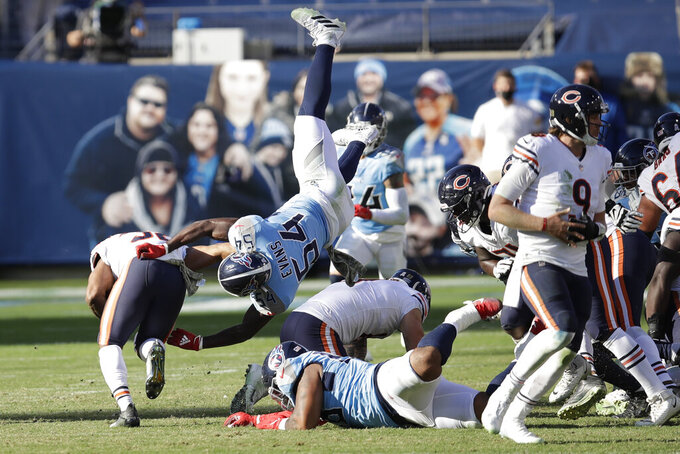 Tennessee Titans inside linebacker Rashaan Evans (54) tries to stop Chicago Bears running back David Montgomery, left, in the second half of an NFL football game Sunday, Nov. 8, 2020, in Nashville, Tenn. (AP Photo/Ben Margot)