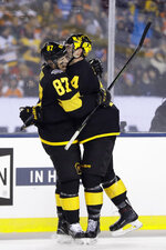 Pittsburgh Penguins' Sidney Crosby, left, and Justin Schultz celebrate after Schultz's goal during the second period of an NHL Stadium Series hockey game against the Philadelphia Flyers at Lincoln Financial Field, Saturday, Feb. 23, 2019, in Philadelphia. (AP Photo/Matt Slocum)