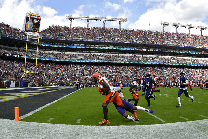 FILE - In this Sept. 29, 2019, file photo, Cleveland Browns wide receiver Jarvis Landry (80) tries to score as Baltimore Ravens defensive back DeShon Elliott makes the tackle in the third quarter of an NFL football game in Baltimore. Landry, who did not return to the game after that play, remains in concussion protocol following the game in which he caught eight passes for a career-high 167 yards in Sunday's 40-25 victory. Coach Freddie Kitchens said Thursday that Landry is still out, and it's not yet known if he'll be available Monday night when the Browns (2-2) visit the San Francisco 49ers (3-0). Landry has also been returning punts this season. (AP Photo/Brien Aho, File)