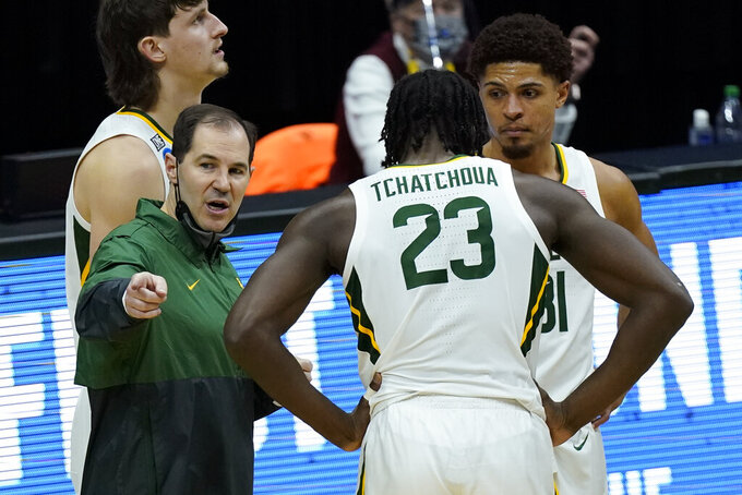 Baylor head coach Scott Drew talks with Tchamwa Tchatchoua (23) during the second half of a college basketball game against Hartford in the first round of the NCAA tournament at Lucas Oil Stadium in Indianapolis Friday, March 19, 2021, in Indianapolis, Tenn. (AP Photo/Mark Humphrey)
