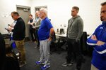 Chicago Cubs president of baseball operations Theo Epstein and manager Joe Maddon watch as Addison Russell answers questions at a press conference after a spring training baseball workout Friday, Feb. 15, 2019, in Mesa, Ariz. (AP Photo/Morry Gash)
